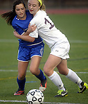4 and 15 (Worcester Ma 111613) Granby 4, Caroline Cyr and  Newburyport Lauren Bean, get wrapped up pursing the ball  in the second half,  during the MIAA State Girls Soccer Division Three final, between Newburyport High and Granby High, Newburyport won the game 1-0, Saturday at Foley Stadium in Worcester. (Jim Michaud Photo) For Sunday
