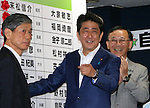 July 10, 2016, Tokyo, Japan - Japanese Prime Minister and ruling Liberal Democratic Party (LDP) president Shinzo Abe pins a rosette on his party's candidates list in the Upper House election at the LDP headquarters in Tokyo on Sunday, July 10, 2016.    (Photo by Yoshio Tsunoda/AFLO) LWX -ytd-