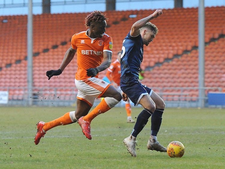 Blackpool's Armand Gnanduillet vies for possession with Walsall's Dan Scarr<br /> <br /> Photographer Kevin Barnes/CameraSport<br /> <br /> The EFL Sky Bet League One - Blackpool v Walsall - Saturday 9th February 2019 - Bloomfield Road - Blackpool<br /> <br /> World Copyright © 2019 CameraSport. All rights reserved. 43 Linden Ave. Countesthorpe. Leicester. England. LE8 5PG - Tel: +44 (0) 116 277 4147 - admin@camerasport.com - www.camerasport.com