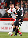 Paul Coutts of Preston holds off Joel Byrom of Stevenage. - Stevenage v Preston North End - npower League 1 - Lamex Stadium, Stevenage - 9th April, 2012. © Kevin Coleman 2012