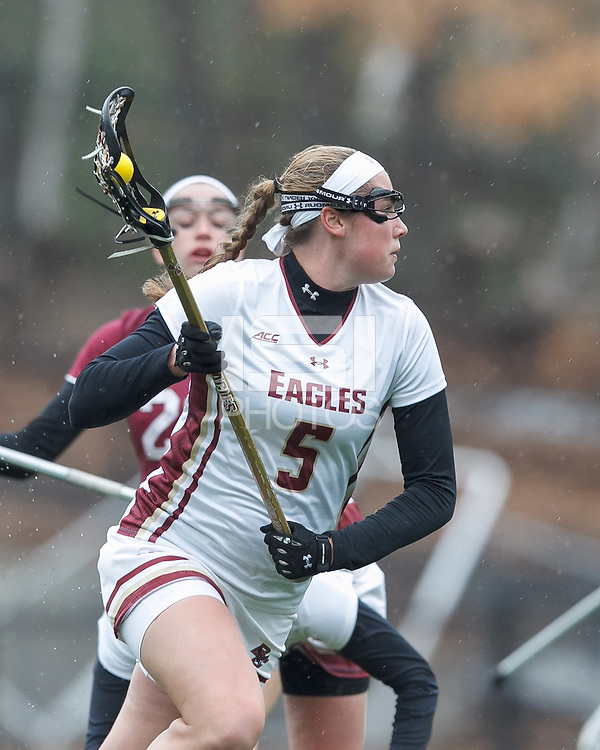 Newton, Massachusetts - April 7, 2015: NCAA Division I lacrosse. Boston College (white) defeated Harvard University (crimson), 19-13, on Newton Campus Field at Boston College.