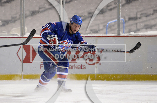 Scott Metcalfe (10) takes a shot on goal during The Frozen Frontier Buffalo Sabres vs. Rochester Amerks Alumni Game at Frontier Field on December 15, 2013 in Rochester, New York.  (Copyright Mike Janes Photography)