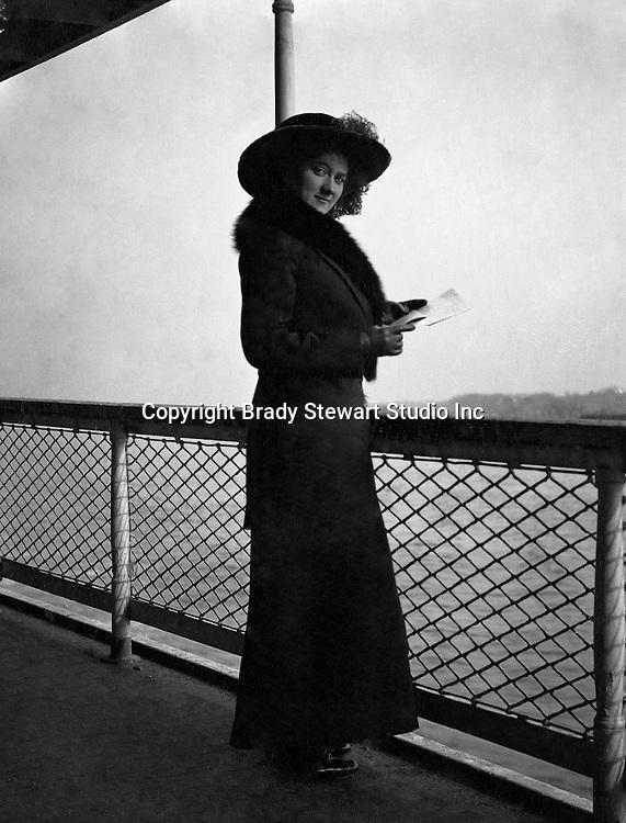 Washington DC:  Sarah Stewart standing next to the ship's railing while taking a cruise on the Potomac River - 1912. Brady and Sarah  Stewart site seeing in Washington DC while on their honeymoon.