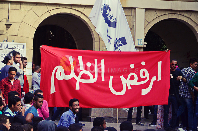 "Egyptian students of the Cairo University, take part in a demonstration demanding for release their kidnapped fellow students by the police, in Cairo on November 11, 2014. The East Cairo Prosecution referred on Monday three students at al-Azhar University to the criminal court for accusing of inciting violence and taking part in ""riots"" within the university campus during protests held on October 21. Photo by Amr Sayed"