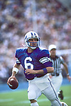 6 Robbie Bosco scrambles during BYU's Homecoming vs Wyoming.<br /> <br /> Oct. 13, 1984<br /> FTB 1984 485<br /> <br /> Photo by Mark Philbrick/BYU<br /> <br /> &copy; BYU PHOTO 2009<br /> All Rights Reserved<br /> photo@byu.edu  (801)422-7322