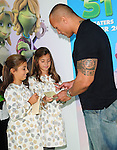 Dwayne Johnson signs autographs at The Columbia Pictures' L.A. Premiere of Planet 51 held at The Mann's Village Theatre in Westwood, California on November 14,2009                                                                   Copyright 2009 DVS / RockinExposures