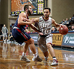 SIOUX FALLS, SD - MARCH 9:  Bishop Smith #10 from IU East tries to get a step past Jake Feickert #12 from Oklahoma Wesleyan in their second round game at the 2018 NAIA DII Men's Basketball Championship at the Sanford Pentagon in Sioux Falls. (Photo by Dave Eggen/Inertia)