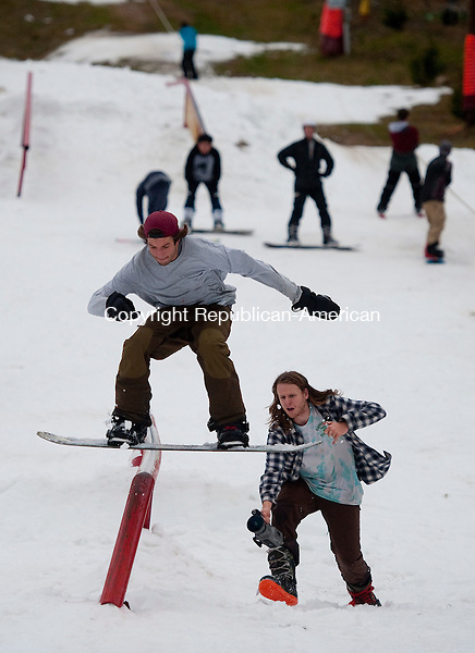 WOODBURY, CT--- -122615JS05--With Connor Lowe filming, right,  Grayson Grazia of Sherman grinds the rail while snowboarding Saturday at the Woodbury Ski Area in Woodbury. <br /> Jim Shannon Republican-American