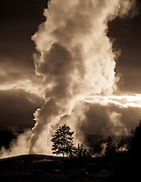 Back-lit Old Faithful at sunset, Yellowstone National Park