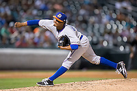 Durham Bulls relief pitcher Jose Dominguez (36) follows through on his delivery against the Charlotte Knights at BB&T BallPark on July 22, 2015 in Charlotte, North Carolina.  The Knights defeated the Bulls 6-4.  (Brian Westerholt/Four Seam Images)