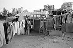 Shatila, the &quot;Nuriyeh&quot; camp (Gipsy) below the Sports city of Beirut. Wet linen drying in front of a shack.<br />  <br /> Chatila, camp des &laquo;Nouriy&eacute;&raquo; dans le &laquo;Hayy el Gharbi&raquo;, en contre-bas de la cit&eacute; sportive. Du linge qui s&egrave;che devant une habitation.