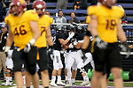 SIOUX FALLS, SD - SEPTEMBER 8: Ty Smith #15 from the University of Sioux Falls lis mobbed by teammates following a touchdown against Northern State in the first half of their game Saturday night at Bob Young Field in Sioux Falls. (Photo by Dave Eggen/Inertia)