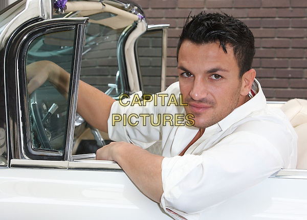 "PETER ANDRE .At a photocall for the launch of ""Peter Andre The Next Chapter"", ITV2, London, England. .October 6th, 2009 .half length white shirt car sitting stubble facial hair .CAP/ROS.©Steve Ross/Capital Pictures."