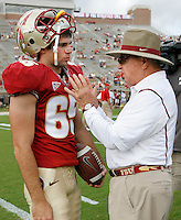 TALLAHASSEE, FL 10/31/09-FSU-NCST FB09 CH05-Florida State Head Coach Bobby Bowden, right, talks with Zack Aronson about wind conditions prior to the N.C. State game Saturday at Doak Campbell Stadium in Tallahassee. .COLIN HACKLEY PHOTO