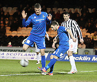 Graeme Shinnie clears as Owain Tudur Jones gets out the way watched by Steven Thompson in the St Mirren v Inverness Caledonian Thistle Clydesdale Bank Scottish Premier League match played at St Mirren Park, Paisley on 30.1.13.