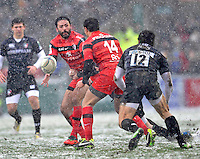 Leicester, England. Clément Poitrenaud of Toulouse passes to Vincent Clerc of Toulouse during the Heineken Cup match between Leicester Tigers and Toulouse  at Welford Road on January  20. 2013 in Leicester, England..