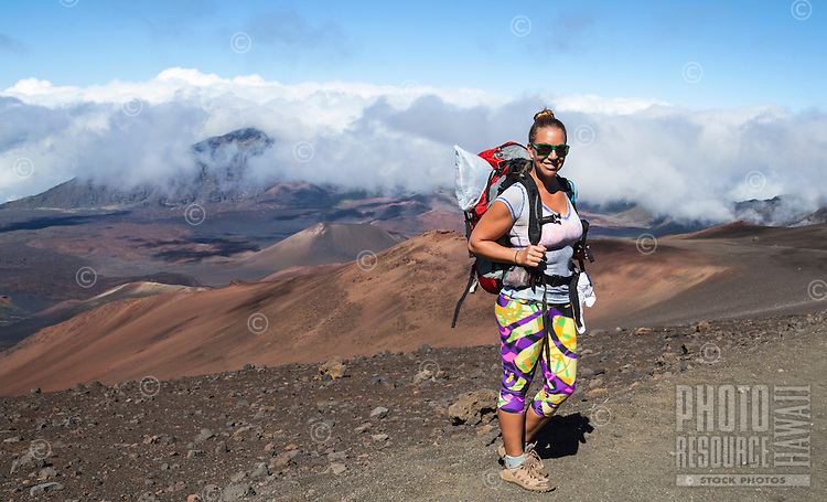 A backpacker pauses on the Sliding Sands Trail at Haleakala National Park on Maui.