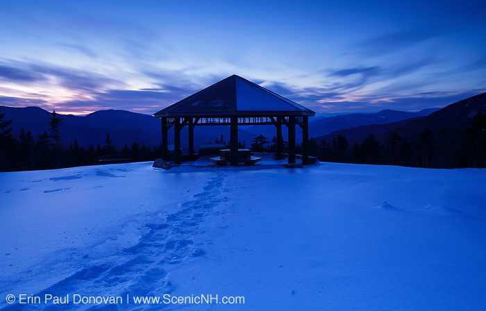 The Pemigewasset Scenic Overlook during night blue hour along the Kancamagus Scenic Byway in the White Mountains, New Hampshire during the winter months.