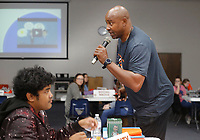 NWA Democrat-Gazette/DAVID GOTTSCHALK Sidney Moncrief speaks Monday, December 3, 2018, to eighth grade honor students at Central Junior High School, during the Moncrief Game Changer Entrepreneurship Summit at the school in Springdale. The summit, sponsored by the Schmieding Foundation, featured workshops that included written expression, sales skills and first impression development.