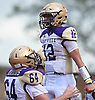 Brock Murtha #12, Sayville quarterback, right, reacts after rushing for a touchdown in the second quarter of a Suffolk County Division 3 varsity football game against host Half Hollow Hills West High School in Dix Hills on Saturday, Sept. 15, 2018. Hills West won by a score of 34-18.