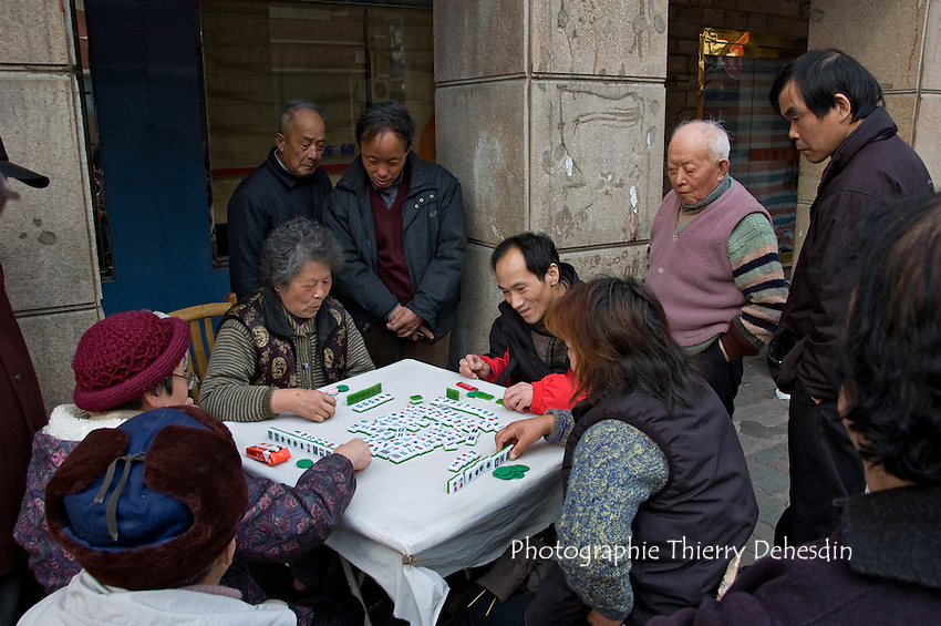 People playing Mah Jongg in the street..Shanghai, February 2006.