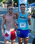 Cary Dunagan, left, finished second to Zachary Hunt, right, in the Reno 10 Mile Run in downtown Reno on Sunday, August 13, 2017.