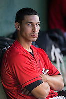 Kannapolis Intimidators catcher Seby Zavala (21) watches the action from the dugout during the game against the Hickory Crawdads at Kannapolis Intimidators Stadium on April 10, 2016 in Kannapolis, North Carolina.  The Intimidators defeated the Crawdads 10-3.  (Brian Westerholt/Four Seam Images)