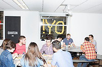 Employees gather during a team lunch meeting about company policies in the offices of Quantopian in the Downtown Crossing area of Boston, Mass., on Wed., June 1, 2016. Quantopian is a Boston-based start-up that provides a platform for building, testing, and executing stock trading algorithms.