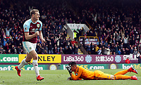 Chris Wood celebrates scoring his sides second goal despite the attentions of Cardiff City's goalkeeper Neil Etheridge (grounded)<br /> <br /> Photographer Rich Linley/CameraSport<br /> <br /> The Premier League - Saturday 13th April 2019 - Burnley v Cardiff City - Turf Moor - Burnley<br /> <br /> World Copyright © 2019 CameraSport. All rights reserved. 43 Linden Ave. Countesthorpe. Leicester. England. LE8 5PG - Tel: +44 (0) 116 277 4147 - admin@camerasport.com - www.camerasport.com