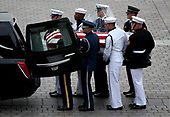 WASHINGTON, DC - SEPTEMBER 01:  A military honor guard team places the casket of the late-Sen. John McCain (R-AZ) into a waiting hearse outside the U.S. Capitol September 1, 2018 in Washington, DC. The late senator died August 25 at the age of 81 after a long battle with brain cancer. Sen. McCain will be buried at his final resting place at the U.S. Naval Academy on Sunday. <br /> Credit: Win McNamee / Pool via CNP