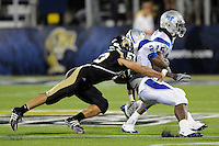 11 October 2008:  FIU linebacker Michael Dominguez (53) tackles Middle Tennessee State running back Phillip Tanner (21) in the FIU 31-21 victory over Middle Tennessee at FIU Stadium in Miami, Florida.