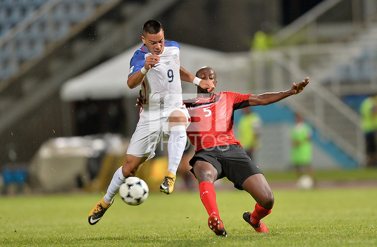 Couva, Trinidad & Tobago - Tuesday Oct. 10, 2017: Bobby Wood, Daneil Cyrus during a 2018 FIFA World Cup Qualifier between the men's national teams of the United States (USA) and Trinidad & Tobago (TRI) at Ato Boldon Stadium.
