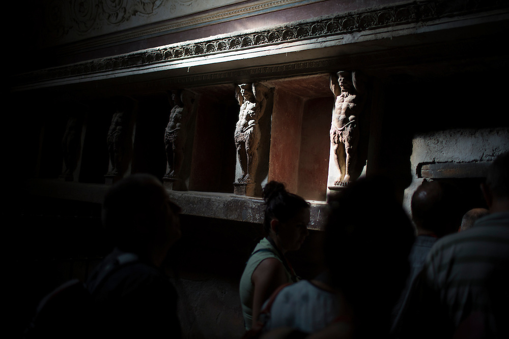 Wall decorations are seen inside the thermal baths on Friday, Sept. 18, 2015, in Pompeii, Italy. The city of Pompeii was destroyed when nearby Mount Vesuvius erupted on August 24, AD 79. The town and its residents were buried and forgotten until the ruins were discovered and eventually excavated hundreds of years later. The ruins are one of Italy's top tourist attractions today. (Photo by James Brosher)
