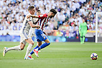 Real Madrid's Toni Kroos and Atletico de Madrid's Yannick Carrasco during La Liga match between Real Madrid and Atletico de Madrid at Santiago Bernabeu Stadium in Madrid, April 08, 2017. Spain.<br /> (ALTERPHOTOS/BorjaB.Hojas)