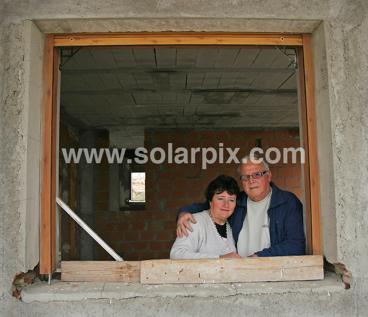 **PICTURES FROM SOLARPIX.COM**.**WORLDWIDE SYNDICATION RIGHTS**.Ex pats property demolition story in the Costa Almeria, in southern Spain...This pic:  John & Liz Brown with their unfinished and abandoned home in Albox..JOB REF:    10937    AB1       DATE:   19.03.10.**MUST CREDIT SOLARPIX.COM OR DOUBLE FEE WILL BE CHARGED**.**MUST NOTIFY SOLARPIX OF ONLINE USAGE**.**CALL US ON: +34 952 811 768 or LOW RATE FROM UK 0844 617 7637**