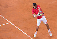 Il serbo Novak Djokovic in azione nel corso degli Internazionali d'Italia di tennis a Roma, 13 maggio 2016.<br /> Serbia's Novak Djokovic returns the ball to Spain's Rafael Nadal during the italian Open tennis in Rome, 13 May 2016.<br /> UPDATE IMAGES PRESS/Riccardo De Luca