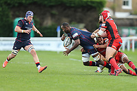 Tjiuee Uanivi of London Scottish is tackled during the Greene King IPA Championship match between London Scottish Football Club and Hartpury RFC at Richmond Athletic Ground, Richmond, United Kingdom on 28 October 2017. Photo by David Horn.