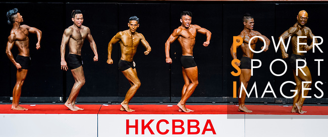 A bodybuilder competes in the South China Men's Athletic Physique 170-173cm category during the 2016 Hong Kong Bodybuilding Championships on 12 June 2016 at Queen Elizabeth Stadium, Hong Kong, China. Photo by Lucas Schifres / Power Sport Images