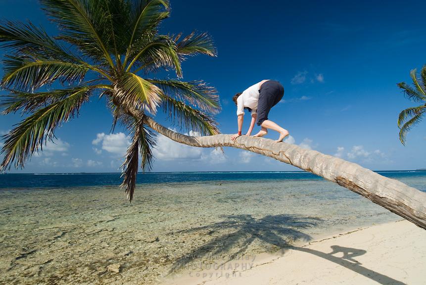 Woman playing along shoreline of tropical island, Comarca De Kuna Yala, San Blas Islands, Panama