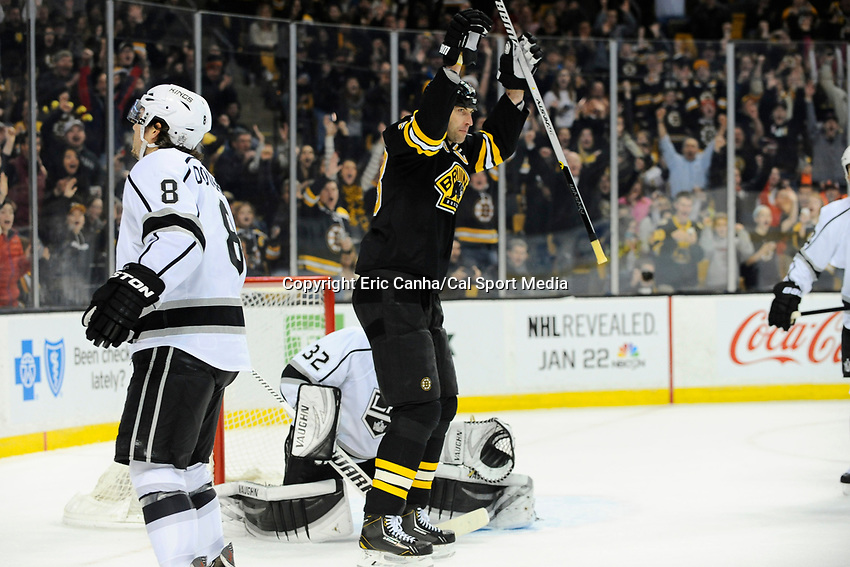 January 20, 2014 - Boston, Massachusetts, U.S. - Boston Bruins defenseman Zdeno Chara (33) celebrates a goal by defenseman Torey Krug (47) during the NHL game between Los Angeles Kings and the Boston Bruins held at TD Garden in Boston Massachusetts.  Eric Canha/CSM