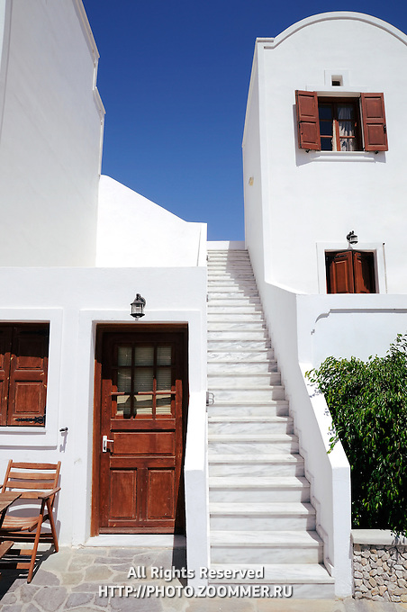 Traditional whitewashed house with staircase in Santorini Greece