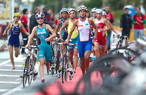 17 SEP 2011 - LA BAULE, FRA - Competitors run into transition at the end of the bike during the final round of the women's French Grand Prix Series at the Triathlon Audencia in La Baule, France .(PHOTO (C) NIGEL FARROW)