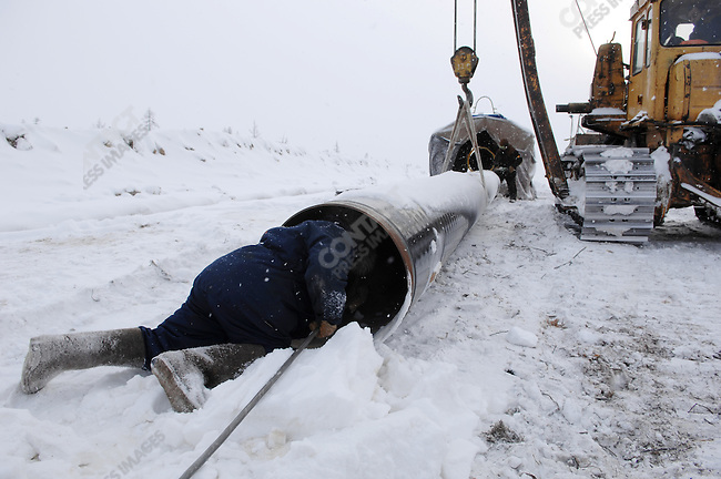 Workers prepared and welding pipes forming a pipeline intented to bring natural gas from wells across the Yuzhno-Russkoye gas field into its central complex for drying and then distribution - the field, one of Gazprom's newest and largest, came on stream in 2007. Yamal-Nenets Autonomous District, Russia, February 28, 2008