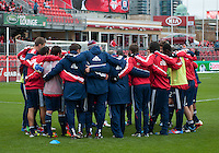 21 April 2012: The Chicago Fire players huddle at the end of warm-up during a game between the Chicago Fire and Toronto FC at BMO Field in Toronto..The Chicago Fire won 3-2....