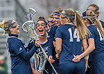 25 April 2015: Members of the University of New Hampshire Wildcat Women's Lacrosse team celebrate an early goal against the University of Vermont Catamounts at Virtue Field in Burlington, Vermont. The Lady Catamounts defeated the Lady Wildcats 12-10 in the final game of the season, advancing to the America East playoffs. Mandatory Credit: Ed Wolfstein Photo *** RAW (NEF) Image File Available ***