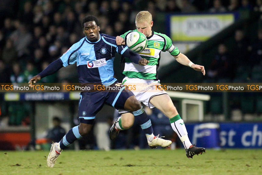 Jon Paul Pittman of Wycombe Wanderers and Yeovil's Craig Alcock challenge for the ball during Yeovil Town vs Wycombe Wanderers, Coca Cola League Division One Football at Huish Park on 26th December 2009