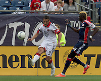 DC United forward Hamdi Salihi (9) passes the ball as New England Revolution forward Saer Sene (39) closes. In a Major League Soccer (MLS) match, DC United defeated the New England Revolution, 2-1, at Gillette Stadium on April 14, 2012.