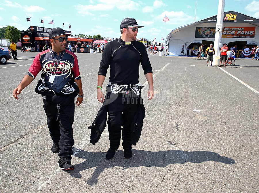 Jun. 2, 2013; Englishtown, NJ, USA: NHRA top fuel dragster driver Khalid Albalooshi (left) walks with Shawn Langdon during the Summer Nationals at Raceway Park. Mandatory Credit: Mark J. Rebilas-