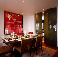 A shiny folding screen separates the dining area from the living room