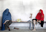 20 August 2011, Kabul, Afghanistan: Two women missing legs  at the International Committee of the Red Cross (ICRC) Orthopaedic Centre in Kabul where victims of war as well as the disabled, are fitted with artificial limbs, hand made on the compound. Picture by Graham Crouch for The Australian Magazine